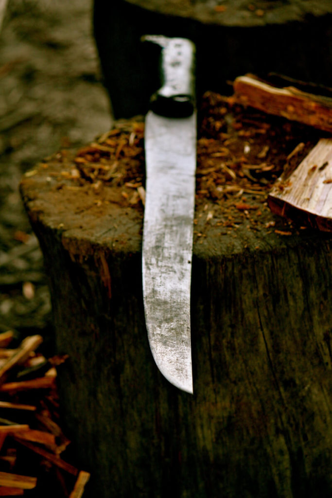 machete on stump with fatwood